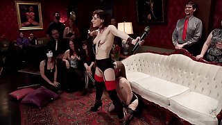 Alice Illustrate and Audrey Holiday are among the subs elbow a BDSM party